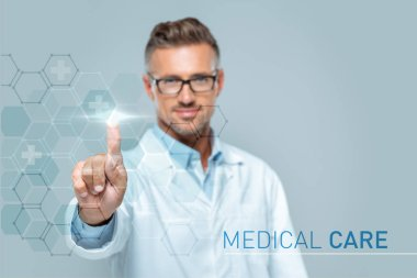 Selective focus of handsome scientist touching medical care interface in air isolated on white, artificial intelligence concept stock vector