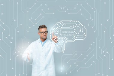 Handsome scientist in glasses touching medical interface with brain isolated on grey, artificial intelligence concept stock vector
