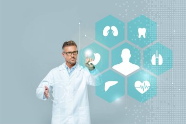 Handsome scientist in glasses touching medical interface isolated on grey, artificial intelligence concept stock vector
