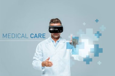scientist in virtual reality headset touching medical care interface isolated on grey, artificial intelligence concept