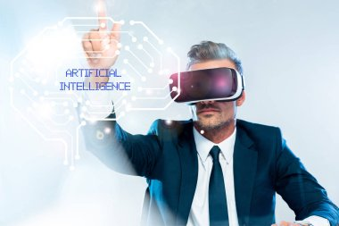 businessman in virtual reality headset touching brain isolated on white, artificial intelligence concept