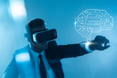 businessman in virtual reality headset with brain isolated on blue, artificial intelligence concept