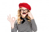 Fotografie blonde woman in glasses holding fake mustache near face and showing ok sign isolated on white