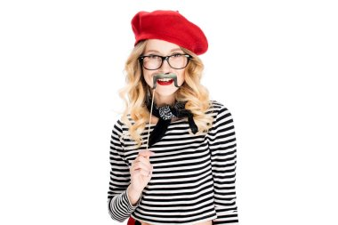 cheerful blonde woman holding fake mustache on stick isolated on white