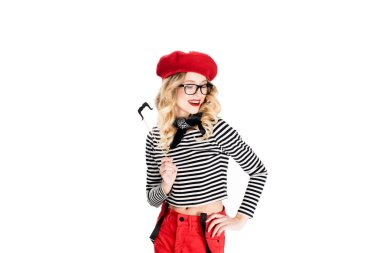 attractive blonde woman in glasses holding fake mustache on stick isolated on white