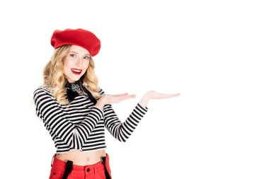 Attractive woman in red beret showing something isolated on white stock vector