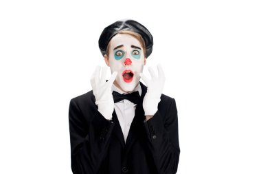 frightened clown wearing white gloves suit abnd black beret isolated on white