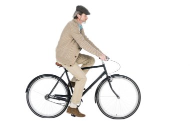 cheerful pensioner riding bicycle isolated on white