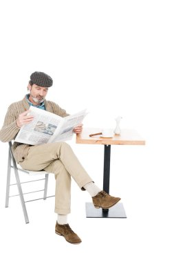 Senior man reading newspaper while sitting on chair with crossed legs isolated on white stock vector