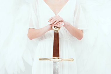 cropped view of woman with angel wings holding sword isolated on white
