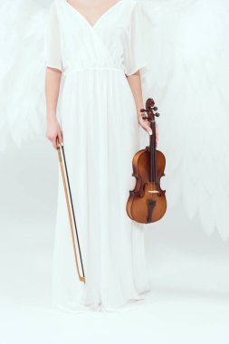 cropped view of woman in angel costume with wings holding violin and bow isolated on white
