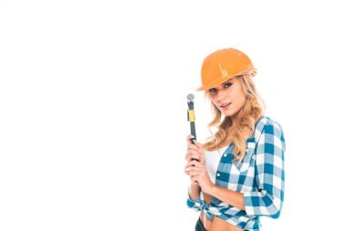 Attractive blonde handy woman in blue shirt, shorts and orange hardhat with hammer isolated on white stock vector
