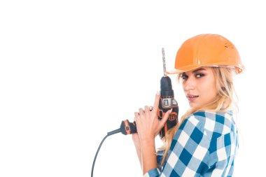 Attractive handy woman in blue shirt and orange hardhat holding screwdriver isolated on white stock vector