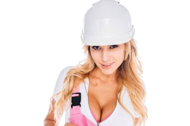 Attractive handy woman in pink and wite uniform, hardhat isolated on white stock vector