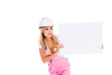 Handy woman in pink uniform and hardhat holding placard isolated on white stock vector