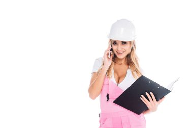 Handy woman in pink uniform with paper tablet talking on smartphone isolated on white stock vector