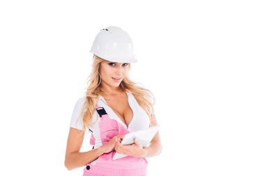 Handy woman in pink uniform standing with digital tablet isolated on white stock vector