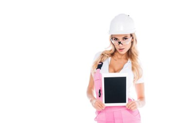 Attractive handy woman in pink uniform and glasses holding digital tablet isolated on white stock vector