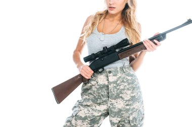 cropped view of militarywoman in grey t-shirt, camouflage pants with weapon isolated on white