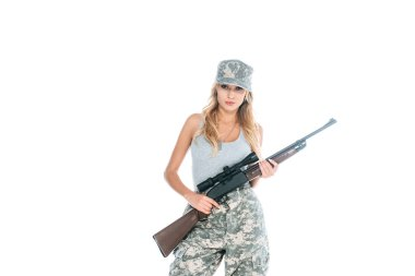 Militarywoman in grey t-shirt, camouflage pants and cap holding weapon isolated on white stock vector