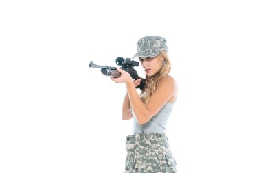 Attractive militarywoman in grey t-shirt, camouflage pants and cap holding weapon isolated on white stock vector