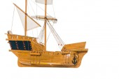 Fotografie vintage wooden ship model floating in air isolated on white