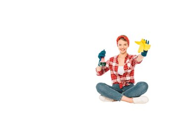 floating girl in jeans and plaid shirt with spray and rag isolated on white
