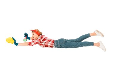 floating girl in jeans and plaid shirt cleaning with rag and spray