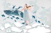 Fotografie plovoucí dívka v modrých šatech se velryba a ptáci ilustrace