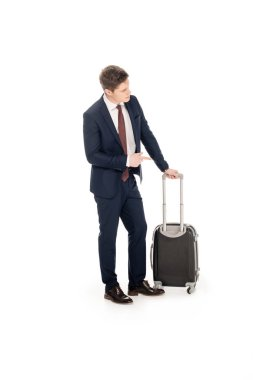 Young businessman in formal wear with suitcase for business trip, isolated on white stock vector