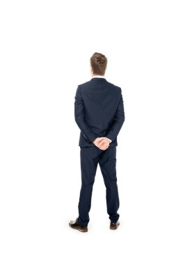 rear view of young businessman standing suit isolated on white