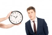 Photo person holding clock near handsome young businessman isolated on white