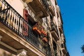selective focus of beautiful house with balconies in barcelona, spain