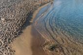Fotografie scenic view of sand coast and calm sea, barcelona, spain