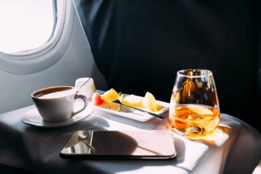 Passenger table in airplane with drinks, snacks and digital tablet stock vector