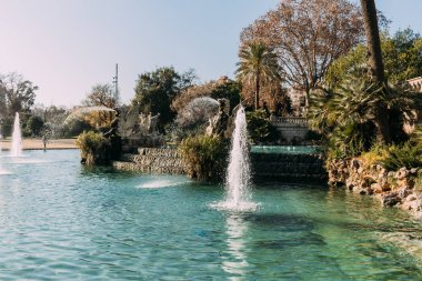 beautiful lake with fountains in ciutadella park, barcelona, spain
