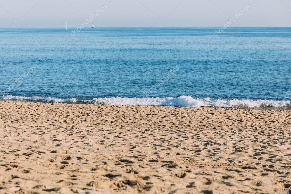 Фотообои BARCELONA, SPAIN - DECEMBER 28, 2018: scenic view of sand beach and blue sea