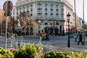 BARCELONA, SPAIN - DECEMBER 28, 2018: busy street with beautiful house on crossroad