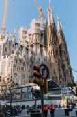 BARCELONA, SPAIN - DECEMBER 28, 2018: selective focus of Temple Expiatori de la Sagrada Familia, one of the most famous buildings of Barcelona, built by Antoni Gaudi, on blue sky background