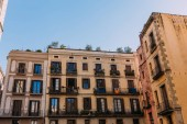 multicolored houses with fenced balconies, barcelona, spain