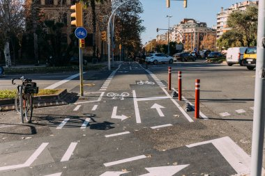BARCELONA, SPAIN - DECEMBER 28, 2018: roadway with bicycle lane, markings and traffic light