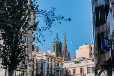 BARCELONA, SPAIN - DECEMBER 28, 2018: urban scene with modern buildings and Temple Expiatori de la Sagrada Familia on background stock vector