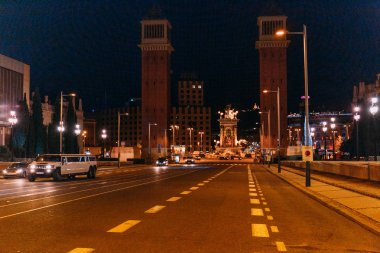 BARCELONA, SPAIN - DECEMBER 28, 2018: night scene of roadway leading to gorgeous Torres Venecianes and Plaza de Espana
