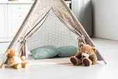 Photo modern interior design of nursery room with baby wigwam and teddy bears