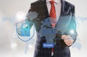 Fotografie cropped view of businessman in suit pointing with finger at cyber security illustration in front