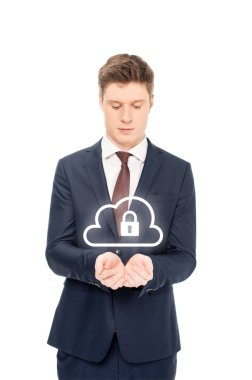 Businessman in suit looking at outstretched hands with internet security icons above isolated on white stock vector