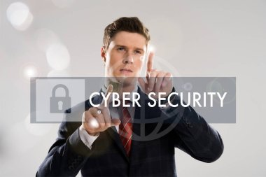 Confident businessman in suit pointing with fingers at cyber security illustration in front stock vector