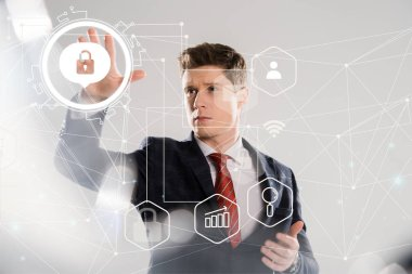 handsome businessman in suit pointing with hands at internet security illustration in front