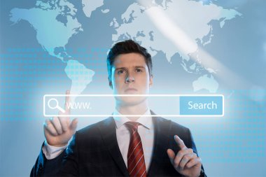 Handsome businessman in suit pointing with finger at search bar in front on blue background stock vector