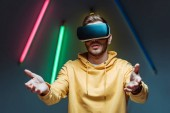 Photo sad young adult and handsome man playing in virtual reality headset